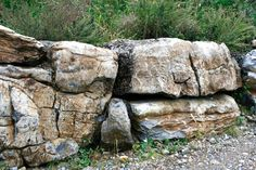 We used the largest Moss Rock Boulders we had to build this wall at our yard (we have on-site walls built with each of the 6 very large retaining wall stones we carry). Description from stoneretainingwalls.net. I searched for this on bing.com/images