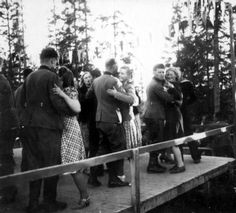 Norwegian women dance with German soldiers, 1940.