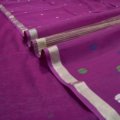 #PadmaPaaduka #Handwoven Magenta Pink Cotton Silk Sari with Jute Bands Pallu ~ Delicate green, white and blue buttas are sprinkled all over this magenta sari. The thin tissue border adds charm and enriches. The pallu is smart with its jute lines against a centre spread of multi-coloured motifs. Code 920512385