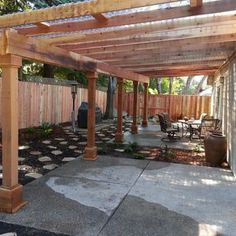 A water efficient back yard with a redwood pergola that has clear corrugated plastic for a roof. - Yelp