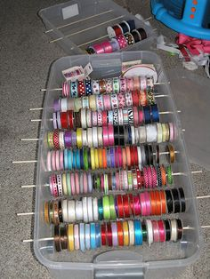 I have probably this many rounds of ribbon!! Great idea...i have them in a plastic container just like this one, but much more handy this way!!