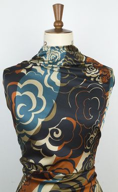 Rust gold and teal printed satin fabric