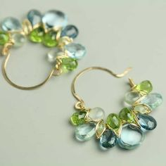 $214 LOVE these peridot & aquamarine earrings. They've sold on etsy but can be purchased at the seller's personal website http://store.fussjewelry.com/blue-topaz-peridot-gem-weave-hoops.html