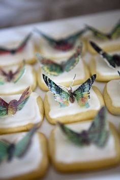 My favorite lemon glazed cookies topped with edible wafer paper butterflies. By Marina @ YummyMummyKitchen.com