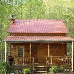 Most log cabis have a tin or metal roof to withstand weather conditions where Colonial homes have wooden roofs.