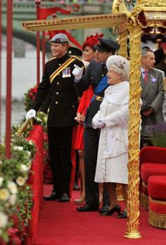Prince Harry, Kate Duchess of Cambridge, Prince William and Queen Elizabeth II watch the proceedings onboard the royal barge during the Diamond Jubilee Pageant on the River Thames in London, Sunday June 3, 2012.