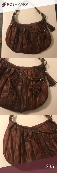 "Sabina New York Hobo Handbag Good condition. Clean. Genuine leather in good condition. This is being used. The leather is in good condition like no cuts no lose threads. H11"" X L 12"" X D 2"" Strap drop 12"". Sabina Bags Hobos"