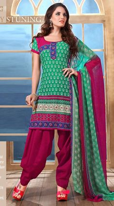 Classy rama green and dark magenta cotton salwar kameez which is adorned with exclusive designer floral printed work all over. This outfit comes with contrast bottom and double shade dupatta.This Salwar Kameez can be stitched in the maximum bust size of 42 inches.