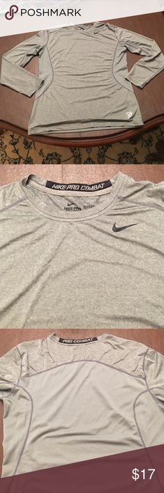 Nike Pro Combat L/S Fitted Shirt Size Medium Dri Fit. Hardly worn, fitted and will fit very slim. Not quite Nike compression fit though. Back and sides are mesh material. WHY NOT Nike Shirts Tees - Long Sleeve