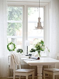 Small table off the kitchen. White on white sure is elegant.