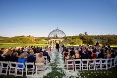 Ceremony at the Reflection Lawn at the Grand Del Mar.  Luxury Wedding Photography by photographer Paul Barnett.