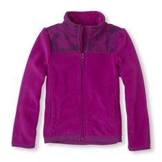 A cozy fleece hoodie with a vivid print she