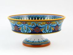 Hand Painted Italian Ceramic 11.8-inch Footed Fruit Bowl Geometrico 64E - Handmade in Deruta 11.8 x 11.8 x 5.5 inches. Can be mixed and matched with other Geometrico patterns for unique dinnerware and kitchenware sets. 100% food safe. Handmade in Deruta, Italy. Signed by the artist. Ships from Italy with fully insured air service. Free shipping over $400. Contact thatsArte for additional Geometric... #Eugenio_Ricciarelli #Kitchen