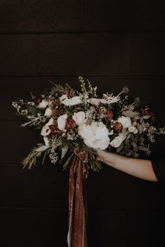 Crushin' on this gorgeously earthy bridal bouquet + its dreamy ribbon | Image by Olivia Strohm Photography