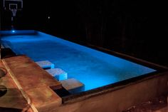 This pool spa combo has it all, benches to set and relax or if you feel more energetic you can play a a little basketball in the pool.  www.masterpoolsofaustin.com #pebbletec #LEDlighting #austincustompoolbuilder #masterpoolsofaustin #masterpoolsguild #pool