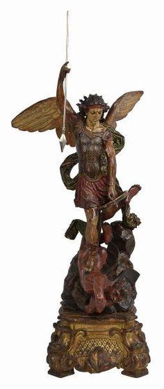 Portugal Sec. XVIII. Imagem de madeira representando São Miguel, o mais popular de todos os arcanjos, é um guerreiro, um cavaleiro, o condestável das milícias celestes que dirige o combate contra os anjos rebeldes que precipita no abismo. Aqui ele aparece usando um elmo, empunhando uma lança fulgurante e portando um escudo. Enquadrado pelas próprias asas que acentuam a verticalidade da figural juvenil, é aqui representado combatendo o dragãodiabo, tal como é descrito no Apocalipse. Base em…