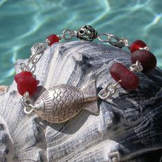 Red sea glass bracelet handmade by Lisl Armstrong.