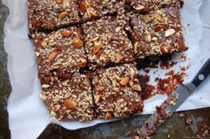 By Alaina Sullivan Despite its simple seven-ingredient roster, this recipe is rich, complex and sinfully delicious. I bolstered the classic version with some nutty additions: ground almonds were substituted for part of the flour, chopped almonds w...