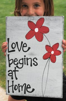 Love Begins at Home wood sign one reclaimed wood. $24.95, via Etsy.