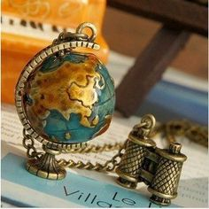 Miniature Travel Globe Necklace makes a nice fashion statement with the long chain.