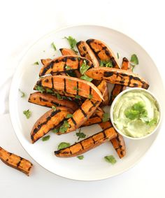 Grilled sweet potato wedges with avocado cream sauce for dipping are the perfect easy, healthy side dish to go with burgers, grilled chicken and more!
