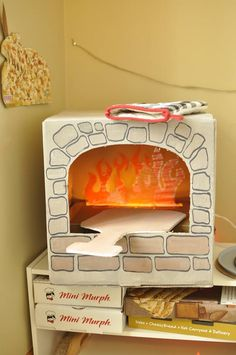 Cardboard pizza oven! A fun craft for your next pizza party! #pizzaparty #crafts