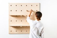 Bang Bang Peg Board. The wall-mounted shelving system stores and displays objects, tools and clothing. With moveable shelves and pegs, the pegboard can be adapted to suit your store, café, home or office. Made from architectural grade Birch plywood. For More information head over to www.georgeandwilly.com