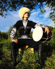 Caucasus men are famous for their virtuoso hand drum playing. Costume style: early 20th century.