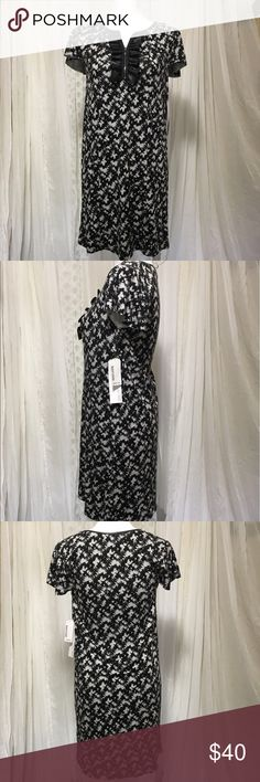 Kenzie fog melange combo dress size small NWT Kenzie fog melange combo dress size small. Black and gray dress with faux leather raffle and trim around the neck. Cute zipper going down ruffle. Flowy feminine cap sleeves. Two seems going down the front to flatter your figure.  Chest 16 inches Length 35 inches Dress 95% viscose  5% spandex Faux leather  58% polyurethane  42% polyester  The fabric is extremely soft with a little stretch. Great dress to have in your wardrobe. Dress it up or dress…