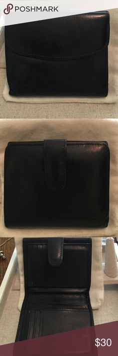 Coach wallet Vintage Coach wallet circa 2000. In excellent condition but leather is soft and broken in from use. Measures 4 1/2 inches wide and 4 inches long (when closed). It has separate pocket for change and two slots for money, receipts, etc. 6 slots for cards and 4 more slots for other items. Coach Bags Wallets