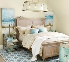 Watery blues give this bedroom a light and airy feel.