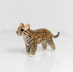 RESERVED for Alexandra Ocelot Figurine OOAK Handmade Polymer Clay Animal Totem by RamalamaCreatures on Etsy https://www.etsy.com/listing/205480413/reserved-for-alexandra-ocelot-figurine