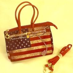 """CLEARANCE   Adorable patriotic mini purse. ⚪️ NWOT small handbag.  Silky nylon and canvas bag with weathered flag design.  One main compartment with zippered interior pocket.  Includes removable shoulder/cross body strap and side snaps to expand bag.  Measures approx 7"""" long by 5"""" tall; 4"""" wide at bottom.  Super cute!  ⚪️  God bless America! Bags Mini Bags"""