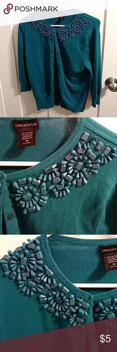 Lord & Taylor beaded teal cardigan Gorgeous Lord & Taylor dark solid teal button up cardigan. 3/4 sleeve, intricate designed beaded pattern on front neck line. All intact. Great sweater light and comfy some slight pilling from normal wear and wash no holes stains pulls Lord & Taylor Sweaters