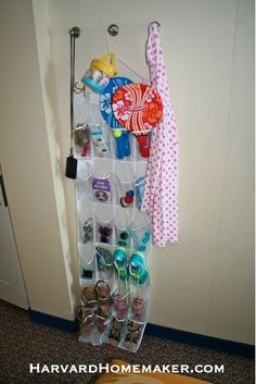 Pack a shoe rack if you go on a cruise.  There's not much counter space in those small rooms, but you can still find a way to keep track of your stuff this way!  #travel #tips #cruise #organize #harvardhomemaker
