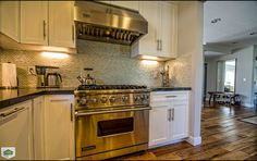 "This article was originally published on Houzz on July as ""How to Recycle Your Kitchen,"" and is presented here with permission. Read the original article. Behind Stove Backsplash, Cheap Backsplash Tile, Kitchen Backsplash, Kitchen Cabinets, Granite Backsplash, Old Kitchen, Kitchen Items, Houzz, Coffee Theme Kitchen"