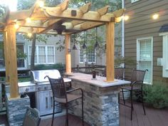 Outdoor bar with pergola, My husband removed an old hot tub that was built into our deck.  Using the  concrete pad that supported the hot tub, he built walls out of block and covered them with stone. During the placement of the block, he inserted 4x4 posts to support the installation of the decorative pergola complete with pendant lights and fan., Patios & Decks Design