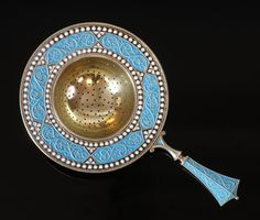 Gustav Gaudernack for David Andersen. Enamelled silver tea strainer in russian style. ca 1895-1905