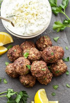 Greek Meatballs with Tzatziki Sauce, perfect for dinner or an appetizer! Full of spices, lemon zest & feta cheese, they'e sure to please Greek food lovers! Greek Meatballs, Spicy Meatballs, Tzatziki Sauce, Mediterranean Diet Recipes, Mediterranean Dishes, Bread Appetizers, Appetizer Recipes, Greek Dinners, Cooking Recipes