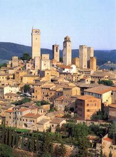 The medieval walled city of San Gimignano rises on a hill dominating the Elsa Valley with its fascinating towers.