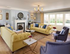 A cosy living space with blues and yellows framed with french doors. Led Light Fittings, The Originals Show, Georgian Architecture, Shaker Style Kitchens, Top 5, Led Candles, Step Inside, Open Plan Living, Modern Family