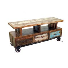 Wooden TV Stand with Wheels. Another Tres Amigos Exclusive! Solid Wood, Heavy, Recycled and Truly One of a Kind! This vintage design tv stand has 3 drawers to help you keep everything organized and ready to access and has wheels for easy movement.