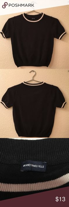 Brandy Melville Black Crop Top Cute crop top from Brandy. The material is a bit thicker because it has sweater like material. Has some slight piling. I'm also selling this in white if you're interested! Brandy Melville Tops Crop Tops