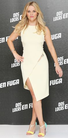 Reese Witherspoon continued to promote her film Hot Pursuit at the Mexico City photocall, pulling out all the stops with a sculptural asymmetric ivory Mugler number that she styled with a single silver bracelet (to match her dress's jewel accent) and summery tri-color T-strap Louboutins.