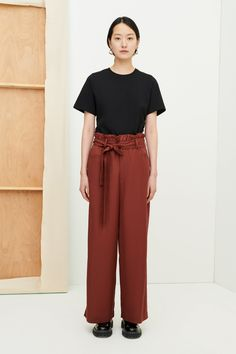 FREE SHIPPING Paper Pant by Kowtow - Wide leg pants with an elastic, paper bag waistband and a removable fabric belt. Made from a smooth tencel twill, the pants have a relaxed fit and feature rounded front pockets and a single back jett pocket. Wide Leg Pants, Fashion Line, Contemporary Fashion, Fabric Material, Trousers Women, Poplin, Organic Cotton, Model, Paper