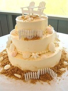 Buttercream Coated, wooden chairs & fencing, real shells & starfish, edible sand; SQUARE $8 serv; ROUND $7.50 serv