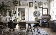 Bohemian dining room filled with vintage mirrors