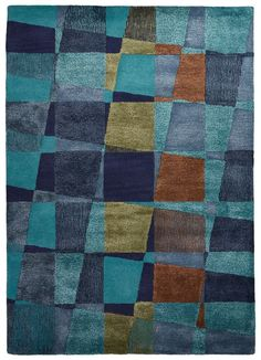 Combining fluid lines with highly textured hand-tufting, this durable, easy care rug in rich shades of pacific and dress blues is constructed using a plush mix of tufted wool and art silk for a lustro