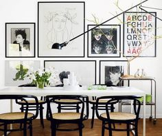 white table + black chairs + graphic posters