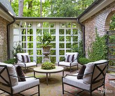 When planning a brick patio, think about the furniture you will be using as well as its placement. This will allow you to create brickwork patterns, such as this patio's circular motif, that highlight specific furniture pieces or design faux area rugs defined with brick borders.